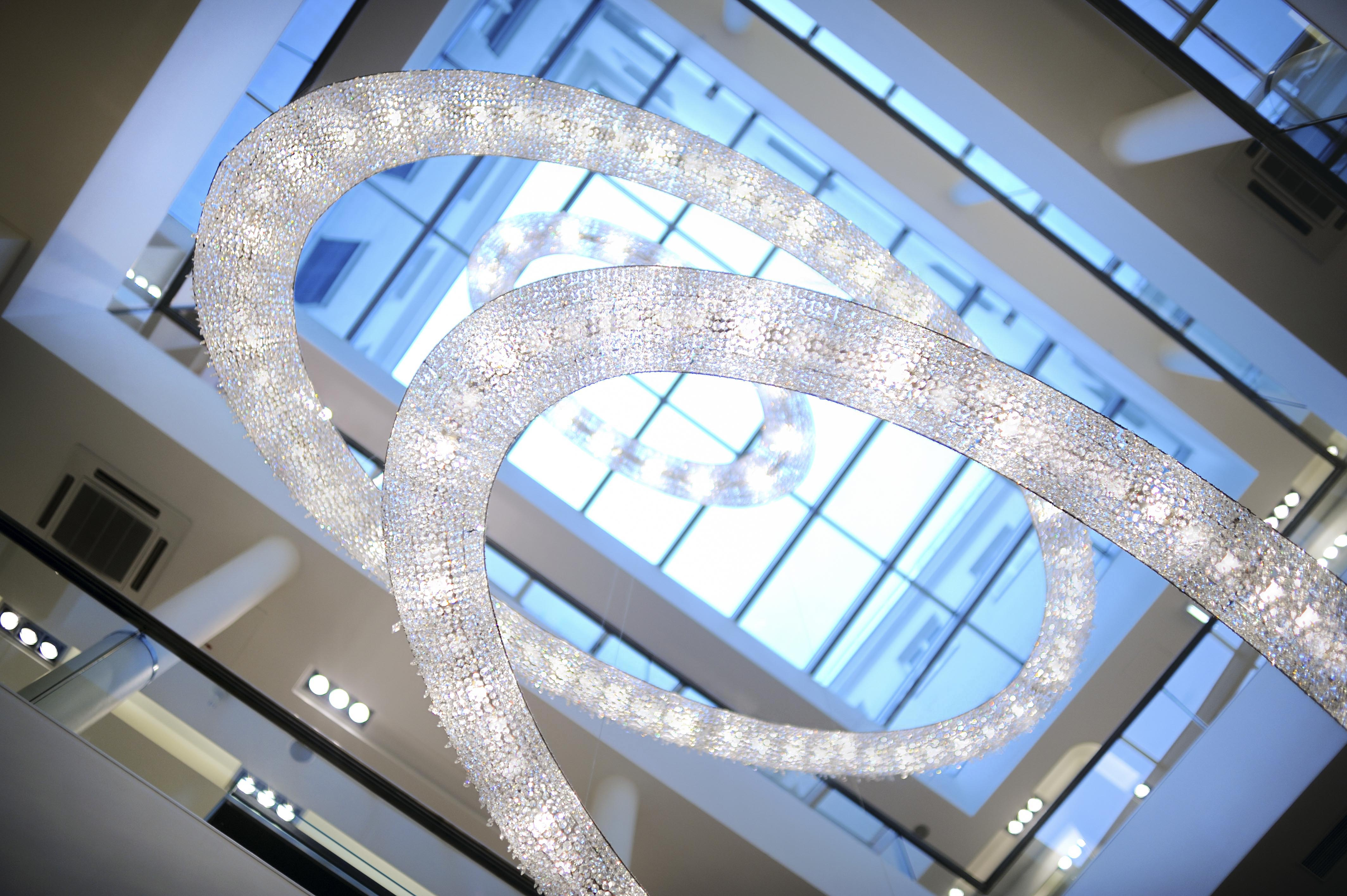 Looop composition illuminates Salamander in Vienna, Manooi Crystal Chandeliers